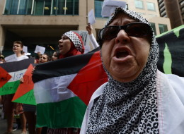 Tempers flared briefly as protesters marched through downtown Ottawa today, calling on Prime Minister Stephen Harper to denounce Israel's military actions in Gaza. (CP)