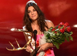 Sandra Bullock Tops Forbes' List Of Highest Paid Actresses. Here, Bullock accepts the Decade of Hotness award onstage during Spike TV's 'Guys Choice 2014' at Sony Pictures Studios on June 7 in Culver City, California. (Photo by Kevin Winter/Getty Images for Spike TV)