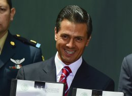 Mexican president Enrique Pena Nieto shows the signed documents of the new law of energy, in Mexico City, on August 11, 2014. (RONALDO SCHEMIDT/AFP/Getty Images)