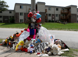 A memorial has popped up near where Michael Brown was shot by officer Darren Wilson. (Photo by Joe Raedle/Getty Images)