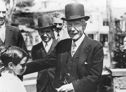 U.S. philantropist and oil magnate John D. Rockefeller gives a dime to a child, in this undated picture. Rockefeller was noted for his habit of giving coins as tips to all and sundry. (AP Photo)