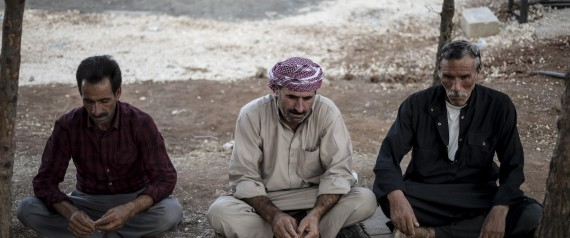Syrian Kurdish men, fled from clashes between the Islamic State militants and PYD forces in Kobani, at refugee camp near Turkey's Syrian border.