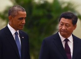 US President Barack Obama (L) walks with Chinese President Xi Jinping at a welcome ceremony in the Great Hall of the People in Beijing on November 12, 2014. Obama began a one-day state visit after the closing of the Asia-Pacific Economic Cooperation summit. AFP PHOTO/Greg BAKER        (Photo credit should read GREG BAKER/AFP/Getty Images)
