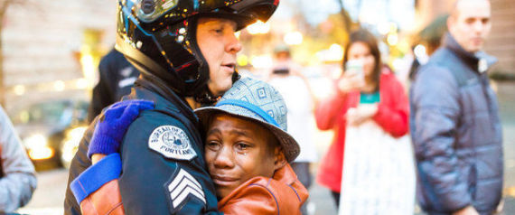 12 YEAR OLD DEVONTE HART HUGS A POLICE OFFICER