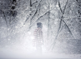 A man walks along in blowing snow Wednesday, Jan. 21, 2015, in Bridgeton, N.J. (AP Photo/Mel Evans)