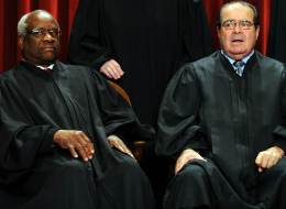 US Supreme Court Associate Justice Clarence Thomas (L) and  Supreme Court Associate Justice Antonin Scalia participate in the courts official photo session on October 8, 2010 at the Supreme Court in Washington, DC.   AFP PHOTO / TIM SLOAN (Photo credit should read TIM SLOAN/AFP/Getty Images)