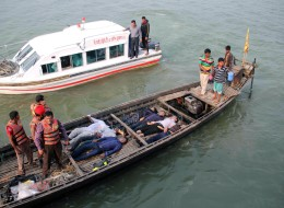 Bangladesh officials stand on a boat laden with the bodies of ferry accident victims at Manikganj some 30kms west of Dhaka on February 22, 2015.  Dozens were feared missing when a ferry sank in central Bangladesh after colliding with a cargo ship, police said. Survivors said the MV Mostofa was carrying between 70-150 passengers when it capsized in the Padma river, local police chief Rakibuz Zaman told AFP.   AFP PHOTO/STR        (Photo credit should read STR/AFP/Getty Images)