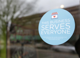 A window sticker on a downtown Indianapolis business announces objection to the Religious Freedom bill passed by the Indiana legislature. (AP Photo/Michael Conroy)
