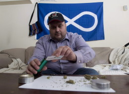 Clayton Goodwin prepares medicinal marijuana at his apartment in Ottawa, Friday March 20, 2015. Former soldiers who want timely access to medical marijuana say they are undeterred despite having being denied a meeting with Veterans Affairs Minister Erin O'Toole. THE CANADIAN PRESS/Adrian Wyld