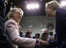 U.S. Secretary of State Hillary Clinton (L) greets Sen. Elizabeth Warren (D-MA) as they arrive for Sen. John Kerry's (D-MA) confirmation hearing before the Senate Foreign Relations Committee to become the next Secretary of State in the Hart Senate Office Building on Capitol Hill January 24, 2013 in Washington, DC. Nominated by President Barack Obama to succeed Hillary Clinton as Secretary of State, Kerry has served on this committee for 28 years and has been chairman for four of those years.  (P