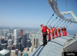 The CN Tower holds a Guinness World Record for its EdgeWalk attraction — the highest external walk on a building. The attraction allows people to walk hands free along a 1.5-metre-wide ledge that surrounds the top of the tower's main pod.  Walkers who venture out in groups of six are secured with a harness during their 150-metre stroll. The walk opened to the public on Aug. 1 2011 and officials say it has attracted thrill seekers from age 13 to 90.