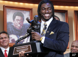 Robert Griffin III, of Baylor University, holds the Heisman Trophy award after being named the winner, Saturday, Dec. 10, 2011, in New York. (AP Photo/Kelly Kline, pool)