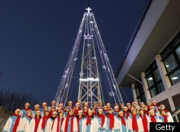 South Korean Christians sing a hymn in front of a Christmas tree atop a military-controlled hill near the tense land border in Gimpo, west of Seoul, on December 21, 2010. (KIM JAE-MYUNG/AFP/Getty Images)