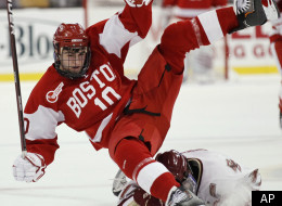 Boston University's Corey Trivino (10) is upended by Boston College's Brian Gibbons during the first period of a Beanpot college hockey tournament game in Boston on Monday, Feb. 7, 2011. (AP Photo/Winslow Townson)