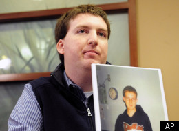 Zach Tomaselli, 23, holds a photo of himself and his brother taken at about the time he claims he was was sexually abused in 2002 by former Syracuse basketball coach Bernie Fine, Thursday, Dec. 8, 2011 in Pittsburgh, Pa. at a news conference where his attorneys, Jeff Anderson and Associates, announced a civil lawsuit to be filed on behalf of Tomaselli, claiming sexual abuse by Bernie Fine. (AP Photo/John Heller)