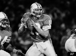 Dan Marino, quarterback for the Miami Dolphins fades back to pass during the first half in Miami, Fla., Dec. 17, 1984 where he broke the season record for most yards thrown. (*AP Photo/Rayt Fairall)
