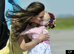 The Duchess of Cambridge hugs six-year-old Diamond Marshall as the Royal Couple arrives in Calgary Thursday, July 7, 2011. THE CANADIAN PRESS/Nathan Dentte