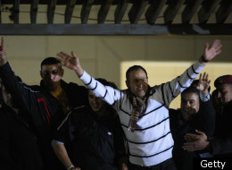 Palestinian prisoners react after being released on December 18, 2011, at the headquarters of President Mahmud Abbas in Ramallah. Israel released 550 Palestinian prisoners to complete a swap deal which brought about the release of captive soldier Gilad Shalit. (Getty)