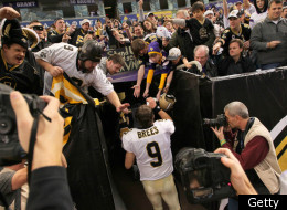 MINNEAPOLIS, MN - DECEMBER 18: Drew Brees #9 of the New Orleans Saints greets fans after the Saints defeated the Minnesota Vikings 42-20 at the Hubert H. Humphrey Metrodome on December 18, 2011 in Minneapolis, Minnesota. (Photo by Adam Bettcher /Getty Images)