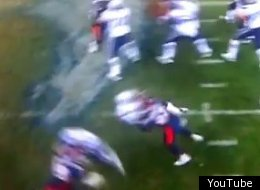 Denver's Elvis Dumervil laid out Pats quarterback Tom Brady.