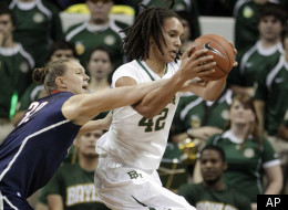 Connecticut's Heather Buck attempts to knock the ball away from Baylor center Brittney Griner in the first half of an NCAA college basketball game Sunday, Dec. 18, 2011, in Waco, Texas. (AP Photo/Tony Gutierrez)