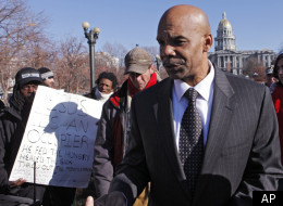 Denver Police Chief Robert White met with Occupy Denver protesters across from the Capitol in Denver on Thursday, Dec. 15, 2011. He told them that the structures at the site were against the law and if they were not taken down the law would be enforced. (AP Photo/Ed Andrieski)