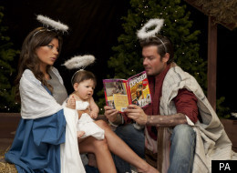 Posh, Becks and baby Harper Seven Look-a-likes posing in a nativity scene.