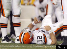 PITTSBURGH, PA - DECEMBER 8: Colt McCoy #12 of the Cleveland Browns lies injured after being hit by James Harrison #92 (not pictured) of the Pittsburgh Steelers during the game on December 8, 2011 at Heinz Field in Pittsburgh, Pennsylvania. The Steelers won 14-3. (Photo by Justin K. Aller/Getty Images)