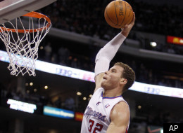 Los Angeles Clippers forward Blake Griffin (32) prepares to dunk the ball as Los Angeles Lakers' Andrew Bynum, lower left, Devin Eubanks (3) and Derek Fisher, back right, watch during the first half of an NBA preseason basketball game in Los Angeles, Wednesday, Dec. 21, 2011. (AP Photo/Alex Gallardo)