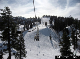 One of the 12 chairlifts that service Bear Mountain hauls skiers up to the top of the slopes.