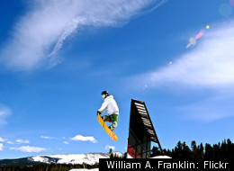 A snowboarder grabs some hang time at Breckenridge Ski Resort.