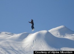 A snowboarder hits the slopes at Alpine Mountain.