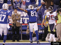 INDIANAPOLIS, IN - DECEMBER 22: Reggie Wayne #87 of the Indianapolis Colts celebrates after catching the game-winning touchdown pass against Kareem Jackson #25 of the Houston Texans at Lucas Oil Stadium on December 22, 2011 in Indianapolis, Indiana. The Colts defeated the Texans 19-16. (Photo by Joe Robbins/Getty Images)