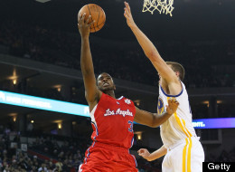 OAKLAND, CA - DECEMBER 25: Chris Paul #3 of the Los Angeles Clippers shoots over David Lee #10 of the Golden State Warriors during the season opener at Oracle Arena on December 25, 2011 in Oakland,