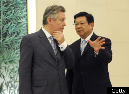 China's Commerce Minister Chen Deming (R) talks with the European Union's trade Commissioner Karel De Gucht at the press conference in Beijing on July 14, 2011.