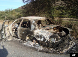 In this photo taken Dec. 24, 2011, a burned out vehicle stands by the of a road near the town of Ixtlan de los Hervores, state of Michoacan, western Mexico. (AP Photo/Gustavo Ruiz)