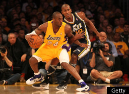 Kobe Bryant #24 of the Los Angeles Lakers controls the ball against Raja Bell #19 of the Utah Jazz at Staples Center on December 27, 2011 in Los Angeles, California.