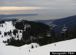 Skiers can look out over the Vancouver cityscape as they make their way down some of the slopes at Grouse Mountain.
