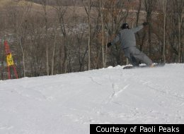 A NASTAR participant races down the slopes.