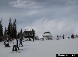 Skiers catch the ski lift at Sunrise Park Resort.