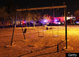 Ciudad Juarez: swing set is empty of children at a crime scene involving the killing of a 13 year old boy in a car