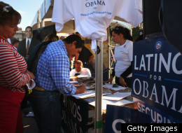 FILE PHOTO: DENVER - SEPTEMBER 14, 2008: A new voter registers at a Democratic Party booth at a celebration marking Mexican Independence Day September 14, 2008 in Denver, Colorado. The Democratic Party is working hard to register Latino voters in Colorado.