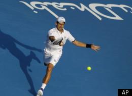 Serbia's Novak Djokovic returns the ball to Roger Federer from Switzerland during the second day of Abu Dhabi Mubadala Tennis Championship, Friday, Dec. 30, 2011 in Abu Dhabi, United Arab Emirates. (AP Photo/Kamran Jebreili)