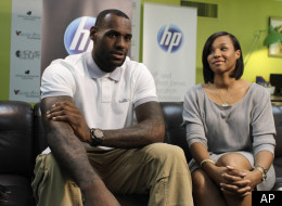 Miami Heat basketball player LeBron James, left, sits with his girlfriend Savannah Brinson during an interview with The Associated Press prior to a charity event at the Northwest Boys & Girls Club in Miami, Wednesday, March 2, 2011. The LeBron James Family Foundation partnered with HP to donate 1,000 computers nationwide to Boys & Girls Clubs of America. (AP Photo/Lynne Sladky)