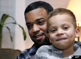 "In this Dec. 27, 2011 photo, Damon Brown sits with his son Julian, 5, at their home in Seattle. Damon Brown found a kidney on Facebook after telling his story on a special page the Seattle dad created under the name, ""Damon Kidney."" His friends and family forwarded the link to everyone they knew and on Jan. 3, a woman his wife has known for years but not someone they consider a close family friend, will be giving him a kidney. (AP Photo/Elaine Thompson)"