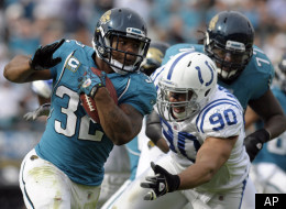 Jacksonville Jaguars running back Maurice Jones-Drew (32) rushes past Indianapolis Colts defensive end Jamaal Anderson (90) during the first half of an NFL football game in Jacksonville, Fla., Sunday, Jan. 1, 2012. (AP Photo/Phelan M. Ebenhack)