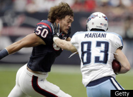 HOUSTON, TX - JANUARY 01: Punt returner Marc Mariani #83 of the Tennessee Titans is tackled by a helmetless Bryan Braman #50 of the Houston Texans at Reliant Stadium on January 1, 2012 in Houston, Texas. (Photo by Bob Levey/Getty Images)