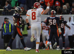 DENVER, CO - JANUARY 01: Quarterback Kyle Orton #8 of the Kansas City Chiefs gestures toward the Denver Broncos bench as running back Dexter McCluster #22 of the Kansas City Chiefs rushes 21 yards for a first quarter touchdown at Sports Authority Field at Mile High on January 1, 2012 in Denver, Colorado. (Photo by Doug Pensinger/Getty Images)