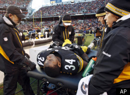 Pittsburgh Steelers running back Rashard Mendenhall is examined on the sideline after an injury in the first half of an NFL football game against the Cleveland Browns, Sunday, Jan. 1, 2012, in Cleveland. (AP Photo/Amy Sancetta)