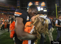 GLENDALE, AZ - JANUARY 02: Justin Blackmon #81 of the Oklahoma State Cowboys celebrates with a cheerleader after Oklahoma State Cowboys won 41-38 in overtime against the Stanford Cardinal during the Tostitos Fiesta Bowl on January 2, 2012 at University of Phoenix Stadium in Glendale, Arizona. (Photo by Donald Miralle/Getty Images)